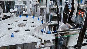 Plastic bottle filling and capping line with screw caps for liquids