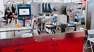 Automatic blistering machine for filling liquids into soft plastic ampoules