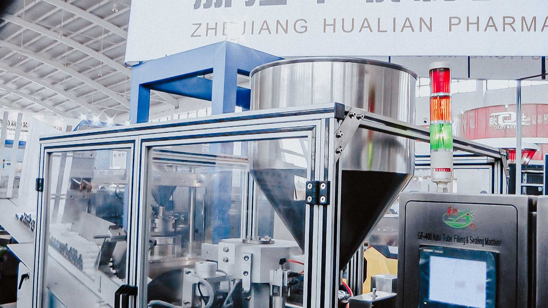 Automatic equipment for dosing and packing cream and ointment in plastic tubes