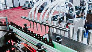 Automatic filling and capping machine for plastic medicine bottles