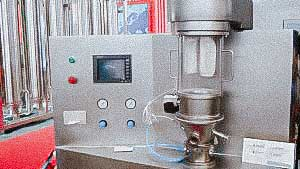 Automatic fluidized bed granulator for tablet protective coating
