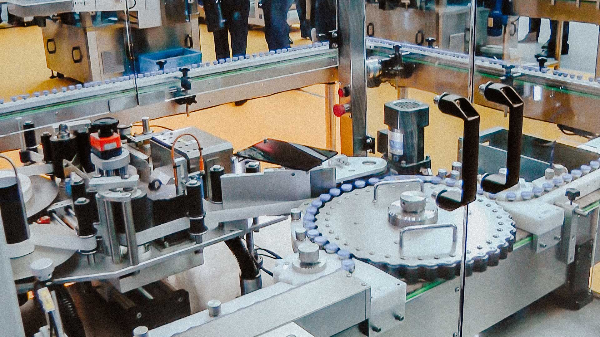 Automatic labeling equipment for sticking self-adhesive labels on penicillin bottles