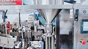 Automatic machine for filling and sealing the cream dosage into plastic tubes USA