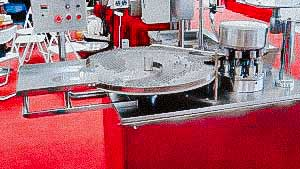 Automatic penicillin bottle filling and capping machine with aluminum caps