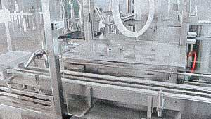 Automatic sterilization washing machine for bottling and capping glass bottles