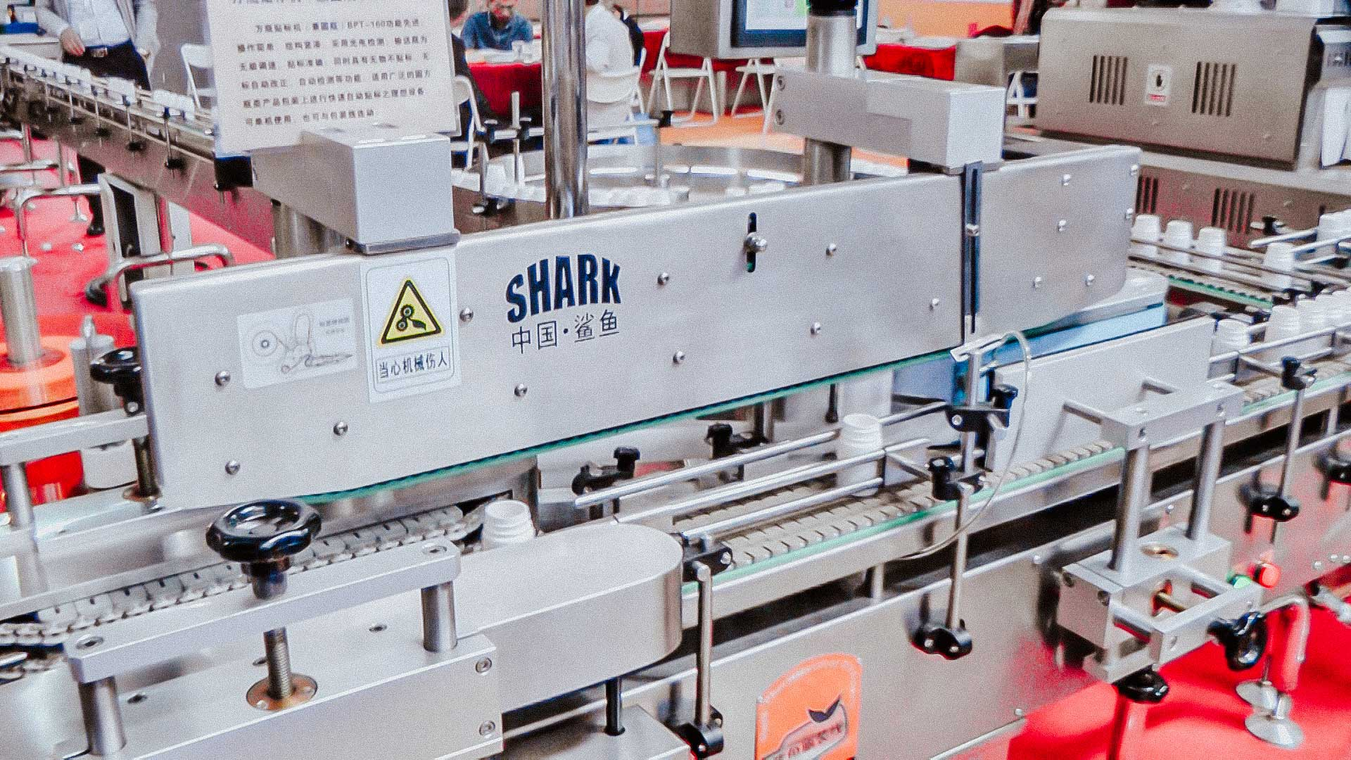 Automatic tablet filling line and plastic bottles and labels sticker