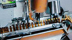 Compact model of pharmaceutical bottling and capping equipment glass vial