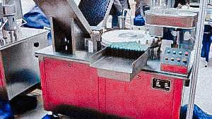 Equipment for automatic filling and capping of penicillin bottles with aluminum caps