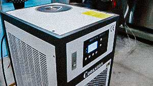 Pharmaceutical cooler to work with various packaging equipment