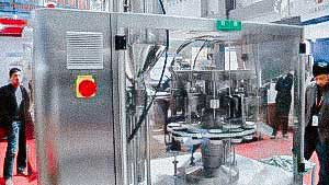 Pharmaceutical equipment for filling and sealing plastic tubes with cream and ointment