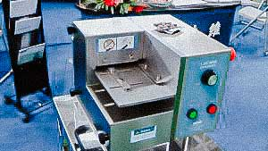 Pharmaceutical equipment for removing tablets and capsules from ready-made blisters