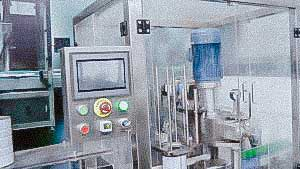 Powder dosage and filling equipment in metal cans with capping metal lid