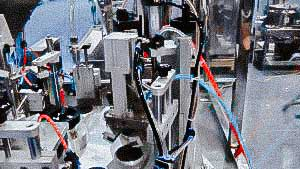 Tube-filling machine for automatic cream filling of plastic tubes