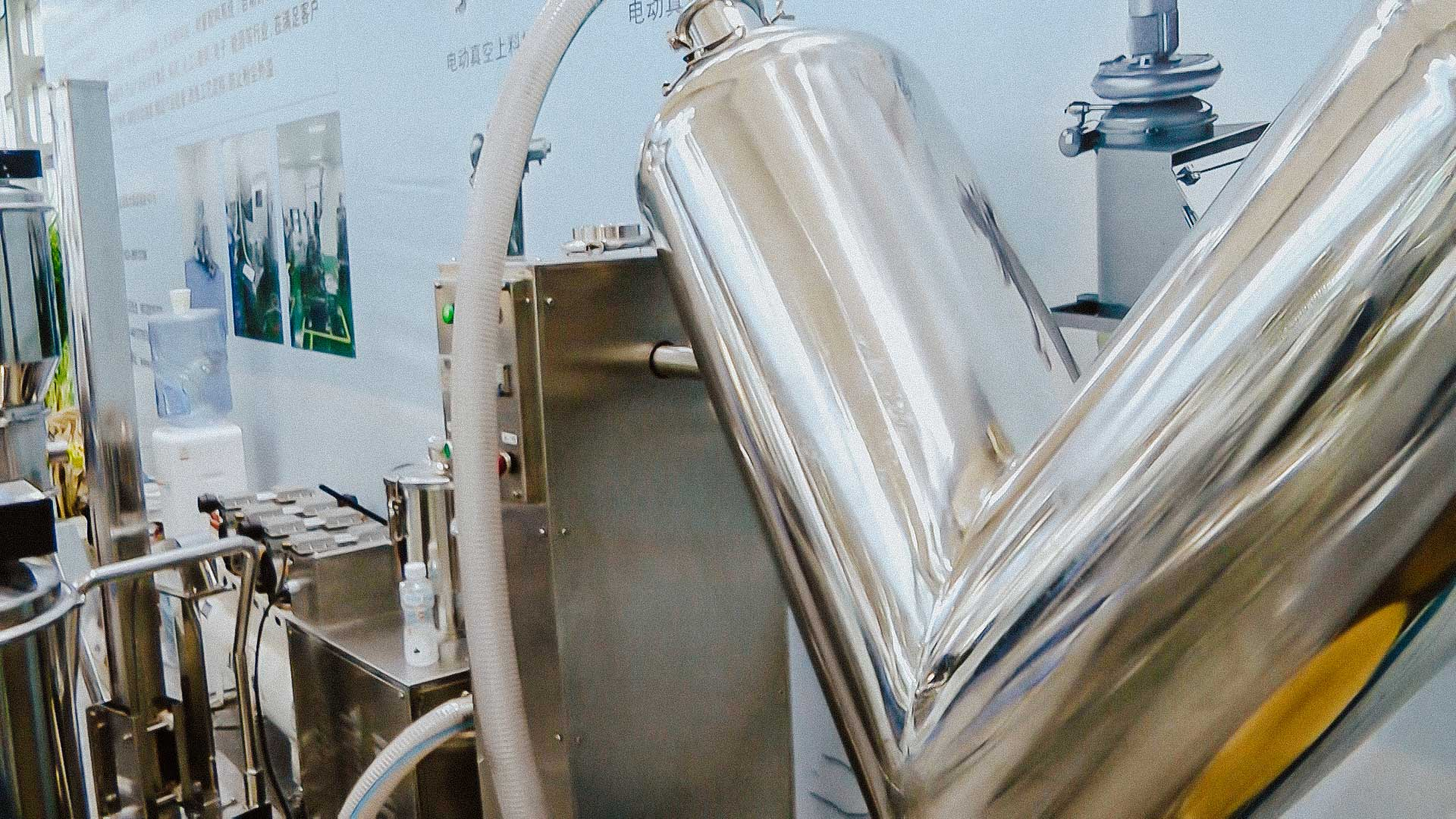 V Mixer for powder mixing and unloading to a vacuum conveyor