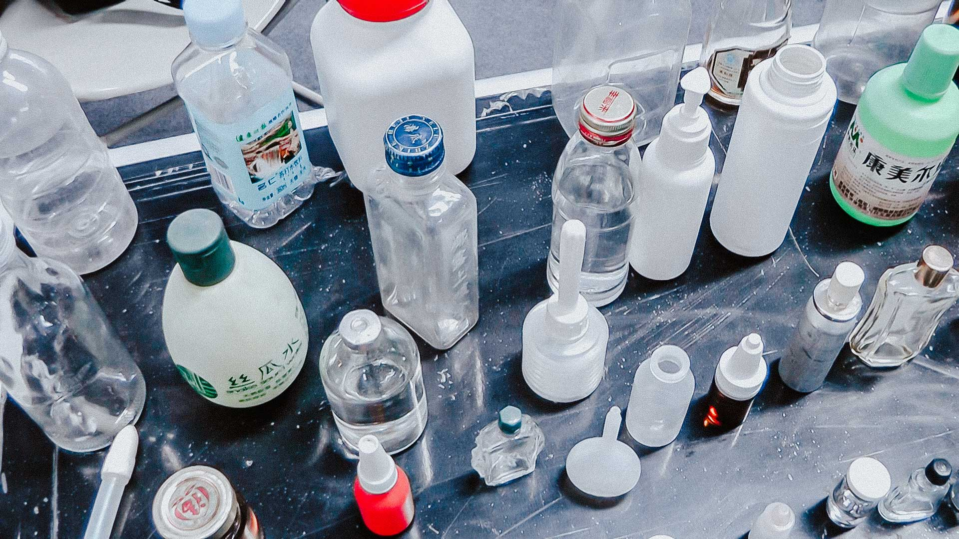 Various samples of glass and plastic bottles for filling in and plugging