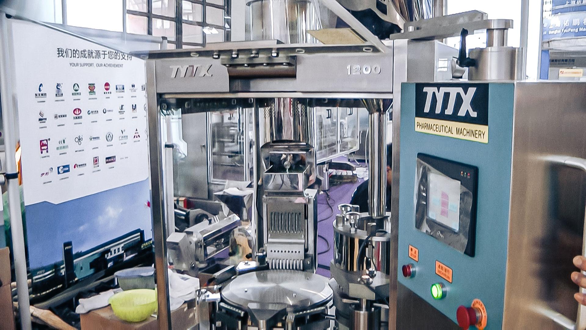 Automatic capsule machine for hard gelatin capsules in pharmaceutical production