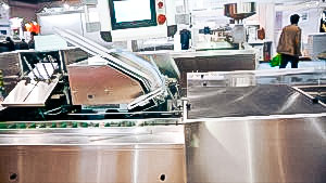 Automatic equipment for blister packaging in carton boxes