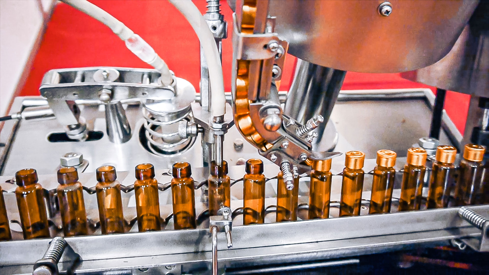 Automatic equipment for filling and capping penicillin bottles