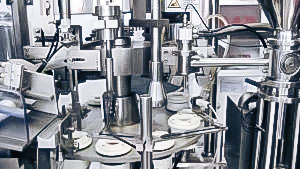 Automatic equipment for filling of cream and ointment in plastic tubes of pharmaceutical production