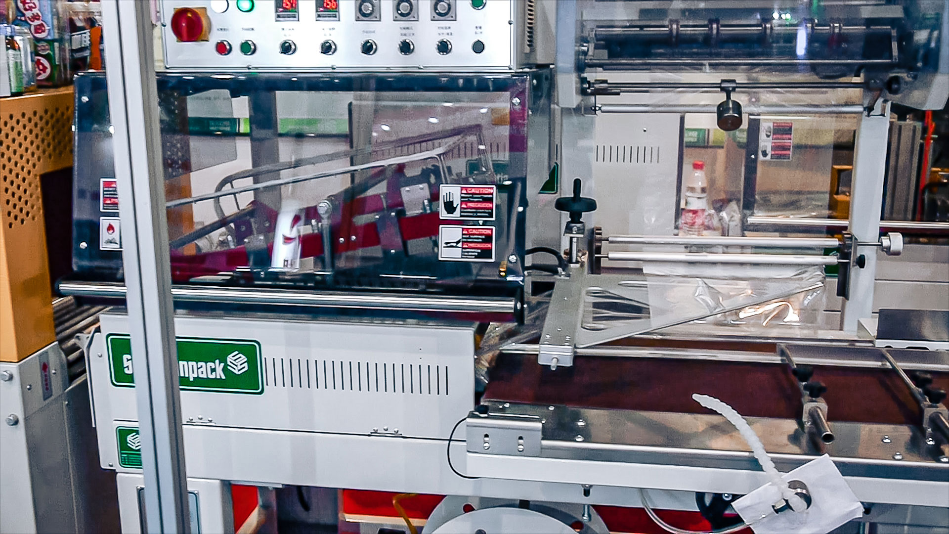 Automatic equipment for logo printing on nuts in chocolate and tablets