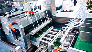 Automatic equipment for packing in cellophane film of medical boxes