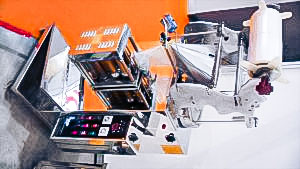 Automatic equipment for packing powders into plastic bags