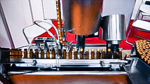 Automatic filling and clamping equipment for aluminum caps