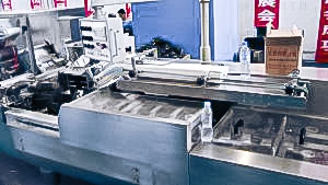 Automatic blister packaging equipment in cardboard boxes in pharmaceutical production