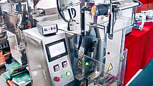 Automatic equipment for packing of products into sashet packs in pharmaceutical production
