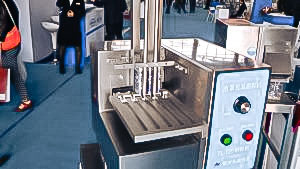 Automatic equipment for removal of gelatin capsules from blisters in pharmaceutical production
