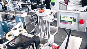 Automatic equipment for sticking self-adhesive labels on bottles of pharmaceutical production