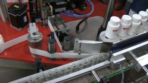 Automatic labeling equipment on penicillin vials in pharmaceutical production