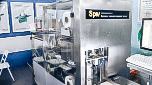 Automatic packaging equipment сardboard boxes in cellophane film in pharmaceutical production